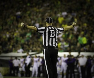 Ref arms stretched