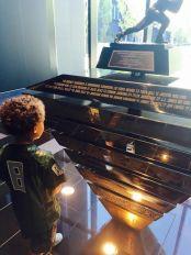Eugene resident, Jordan Giles, looks at his reflection in Permanent Heisman Trophy Display honoring Marcus Mariota